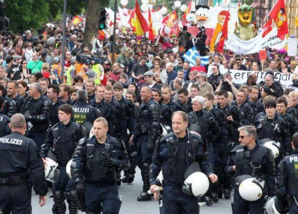 The German police took off their helmets and marched with the protesters- clearing the way for them.